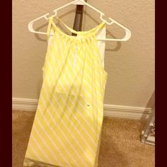 New York & Co. Yellow & White Stripe Halter Top New York & Company Yellow & White Stripe Halter Top.  Cute top!  Size XS.  100% rayon.  Great compliment to any outfit! New York & Company Tops