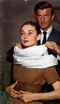Audrey Hepburn and couturier Hubert de Givenchy at a dress fitting for a fashion editorial, April 26, 1958.