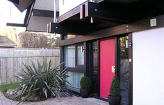 Huf Haus - Attractive front door and small opening window on LHS.