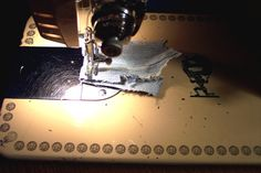 The sewn sample under the presser foot is the leg seam from a pair of Levis, doubled, and it sewed it easily.