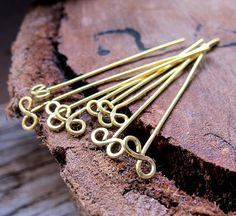 Items similar to Infinity Headpins. Exclusive Design of Brass Head Pins set. Handmade 22 gauge headpins, bow end pins. Infinity Eye pins on Etsy Wire Jewelry Designs, Diy Jewelry Findings, Beaded Jewelry, Jewellery, Wire Crafts, Jewelry Crafts, Wire Wraping, Homemade Jewelry, Head Pins