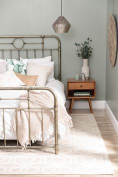 Cutest queen bedframe in this transitional boho bedroom with green tan and whi Boho Bedroom bedframe bedroom Boho cutest Green queen Tan transitional whi Sage Bedroom, Gold Bedroom, Master Bedroom, Bedroom Decor, Bedroom Rustic, Rug For Bedroom, Spare Bedroom Ideas, Emerald Bedroom, Bronze Bedroom