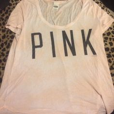 PINK tshirt size L PINK tshirt size large, its an off white, pink mixed t. It has been worn many times, and has one tiny hole as shown in picture 2 next to my thumb. Even though its been worn and washed, there is no piling of the lettering. Open to all bids! Or any questions ☺️ PINK Victoria's Secret Tops Tees - Short Sleeve