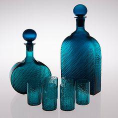 "NANNY STILL - ""Flindari"" glass carafes and tumblers for Riihimäen Lasi Oy, Finland. [h. 32, h. 23,5, h. 7,5 cm]"
