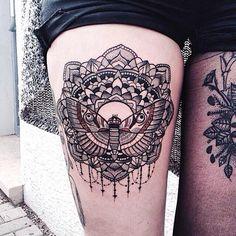 moth tattoo on leg