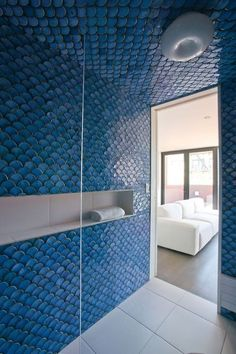 Loving the blue wall tiles... not too keen on the white floor tiles though.