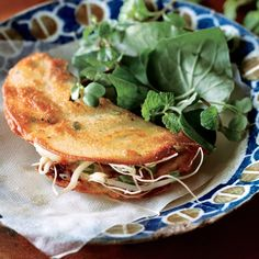 To see step-by-step photos and detailed instructions on making these hot and crunchy filled crepes (known as banh xeo).