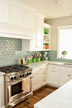 """Loads more details for this reno if you click over -- Gray wall color is """"Whippoorwill"""" by Millenium Paint. (you can get ANY color in small $2.50 samples at Lowes.) ; 3""""x6""""glass tile by Dal Tile -- Whisper Green"""