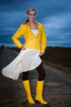 Yellow leather jacket, white skirt, black leggings, yellow rubber wellies boots