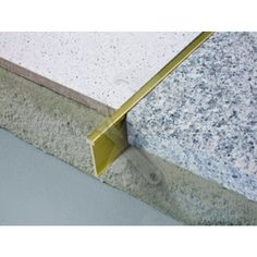 Schluter TERRAZZO Decrative Divider Brass £26.39 /2.5m Length | Buy Schluter Flooring Transitions Online | Northants Tools