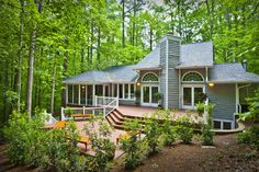 This! This home or similar in a setting just like this. I love the trees, the privacy and all the windows. Perfect.