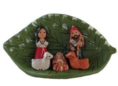 Hand-painted ceramic nativity featuring Mary, Joseph and Baby Jesus in traditional Andean dress