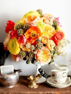 citrus hued florals for centerpieces