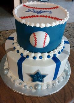 Dodgers and Dallas - This was for a fan of the LA Dodgers and the Dallas Cowboys. All pastry pride. Top tier is covered with ble Wilton sugar sheets. They wont turn your teeth blue, haha! Baseballs and star are gumpaste.