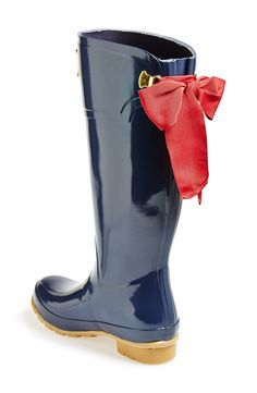 Oh, so pretty. Love the red bow on these rain boots.