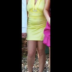 Yellow dress My Michelle yellow dress with sparkle ring in middle of dress. Halter style back. Bunches on sides. Very pretty. My Michelle Dresses