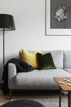 a grey sofa is perfect if you want to change the mood of your room simply updating the colours of your pillows!