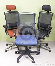 High-end office chairs covered with red and black leather and blue cover http://www.photokameljurkowski.pl