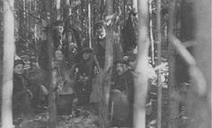 Jewish partisans, survivors of the Warsaw ghetto uprising, at a family camp in Wyszkow forest. Poland, 1944.
