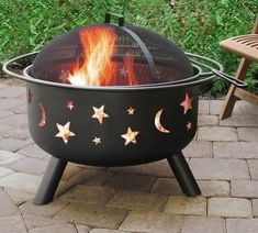 """This 23.5"""" fire pit adorned with stars and moons. 