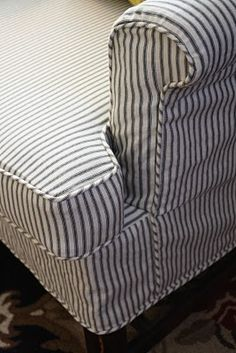 Ticking fabric works great for slipcovers. It's especially looks cute on wing chairs and camel back sofas or settees. Ticking Fabric, Ticking Stripe, Striped Couch, Pillow Fabric, Banquette, Ticks, Apartment Therapy, Bungalow, Decoration