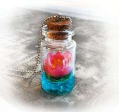 Lotus flower on a magic lake bottle necklace vial by UraniaArt http://www.etsy.com/listing/156522305/lotus-flower-on-a-magic-lake-bottle?ref=related-4