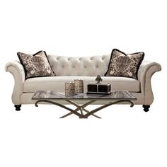 Showcasing rolled arms and a button-tufted back, this timeless sofa in ivory brings a touch of classic elegance to your living room or parlor.  ...