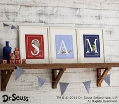 Dr. Seuss™ Alphabet Prints on that adorably easy (to make) shelf with bunting to boot.   Home run on this one.
