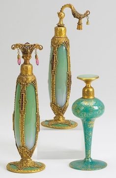 Aquamarine, Aqua and gold glass perfume bottles and atomizers. Stueben for De Vilbess Perfumizers Co. Circa. 1920's.