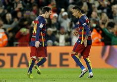 Messi (left) and Neymar celebrate after the Argentine's free-kick brought Barcelona level against Sevilla on Sunday