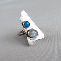 sterling silver cocktail ring with blue chalcedony and rainbow moonstone. $95.00, via Etsy.