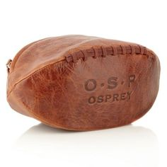 297c515681 P Rugger washbag is an ideal gift for the true sports fan. Created in the  style of a traditional four-panelled rugby ball in genuine Old Saddle  leather.