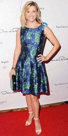 REESE WITHERSPOON Reese delivers the perfect ladies-who-lunch look in a floral-print Oscar de la Renta dress and Manolo Blahnik sandals at the Colleagues' Spring Luncheon in L.A.