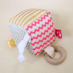 Interactive baby soft block, handmade in Byron Bay by Babee and Me. Pink, gold and silver