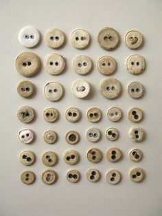 Cloth covered buttons.