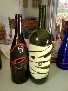 Wine bottles stenciled/painted for Halloween.  Cool to cut with glasscutter and add a candle.