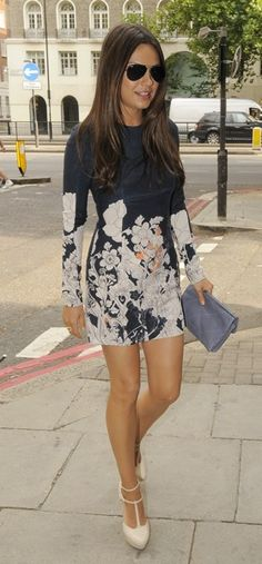 The solid black top and floral bottom of Mila Kunis's mini dress is a winning combination.