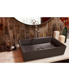 I'm likin' the raised vessel sink and that wall tile.   Percy Vessel Faucet with Loop Handle from DXV
