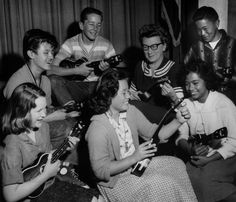 . 1960, Orchard School, San Jose: Sixth-grade teacher Mrs. Timmons (glasses) with members of the school\'s ukulele class: clockwise from center front, Abelina, Bonnie, Harry, Bruce, Keith and Marilyn.