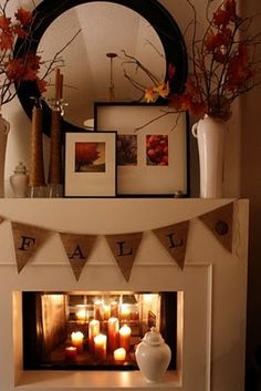 i actually found this is Holiday folder, but i was thinking diy when i saw it. if you don't have a fireplace, why not make one? build a frame outwards around 8 inches or whatever and then put candles inside, i think this looks nice! plus, then you have a mantle to decorate for all seasons! :)