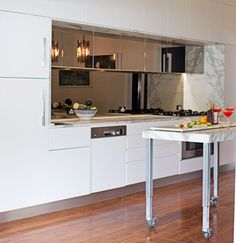 Simone Giorgi Sydney 1950s beach home white modern kitchen carrera marble