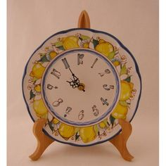 C3 - Medium sized ceramic plate clock with lemons and an intricate pattern, hand crafted and hand painted...a lovely piece of art! Battery operated, this clock may be hung on a wall or used in a plate stand (sold separately)