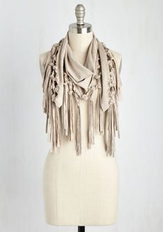 Add a touch of contemporary chic to your ensemble by topping your favorite outfit with this fantastic scarf! Featuring a triangular shape, a knotted, fringed edge, and vegan faux-suede construction, this hip scarf keeps you looking cool while it warms your shoulders!