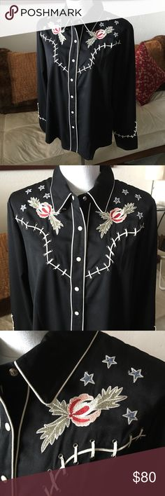 """Scully western shirt embroidered flower skeleton Great Scully western shirt with embroidered flower and skeleton design. Snap buttons. 35% rayon 65% Polyester. Women's size large. Armpit to armpit- 21.5"""" shoulder to shoulder- 16"""" neck to bottom- 26"""". No issues to note. In great condition. Thank you.   00760D Scully Tops Button Down Shirts"""