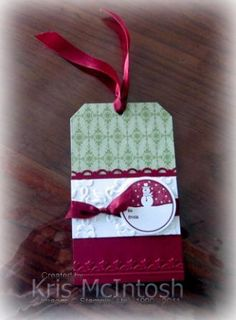 I decided to make a Christmas Tag using the sketch at Stamping 411 this week. I had a Whisper White card stock tag lying on my desk and covered the top half with a piece of Old Olive Designer Paper...