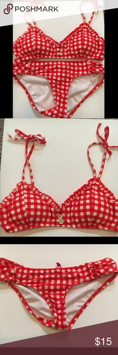 Daisy duke inspired bikini Daisy duke inspired bikini. In good condition never been worn . Has cute little flowers in the middle of the bikini top. THE TOP'S LABEL SAYS XL but FITS LIKE A MEDIUM . Bottoms are mediums . The bikini lab Swim Bikinis