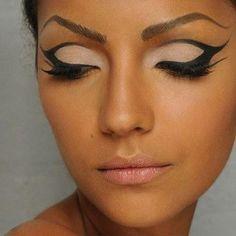 Cat Design Eye Makeup: Cat eye with glow diamante make up.