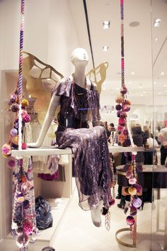 Karen Kimmel custom pom pom swing and gilded butterfly wings for Ella Moss. It would have to be overhead, tho. Showroom Design, Visual Display, Display Design, Visual Merchandising, Store Window Displays, Fashion Window Display, Vitrine Design, Retail Store Design, Glow
