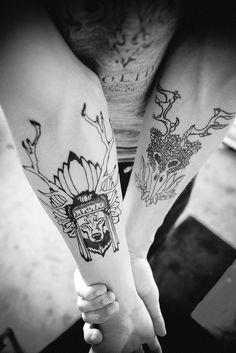 animal spirit with headdress tattoo ink on arms.