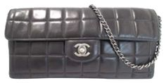 Chanel Classic Medium Flap Silver Chain Chocolate Bar Clutch + Cc Logo Shoulder Bag. Get one of the hottest styles of the season! The Chanel Classic Medium Flap Silver Chain Chocolate Bar Clutch + Cc Logo Shoulder Bag is a top 10 member favorite on Tradesy. Save on yours before they're sold out!